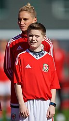 YSTRAD MYNACH, WALES - Wednesday, April 5, 2017: Wales' Jessica Fishlock lines-up with her nephew as a mascot on her 100th appearance ahead of the Women's International Friendly match against Northern Ireland at Ystrad Mynach. (Pic by Laura Malkin/Propaganda)