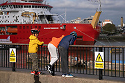 Londoners admire the British Antarctic Survey's new polar research ship, the RRS Sir David Attenborough which, is moored on the Thames at the Prime Meridian, Greenwich, during its short stay on show to the public, during the COP26 Climate Change conference in Glasgow, on 28th October 2021, in London, England. The  £200m Attenborough is a Polar Class 4 icebreaker with state of the art  research equipment, a helipad, cranes, onboard laboratories, and other ocean-survey and sampling equipment.