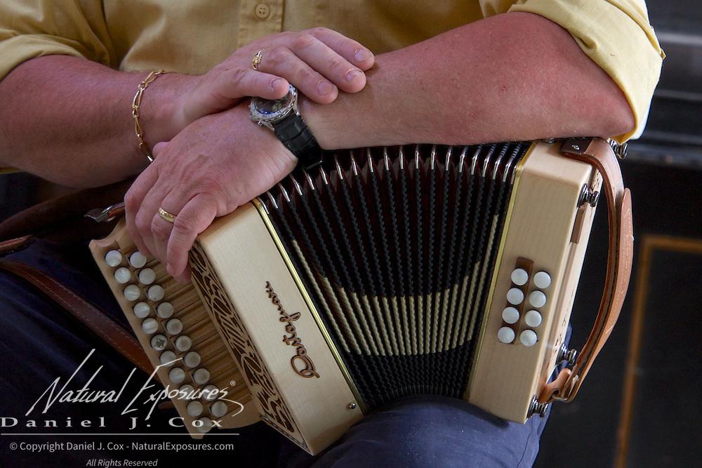 Steve McSweeney plays traditional Irish music on the accordion at the Cnoc Suain Connemara Hill Viallage, Ireland.
