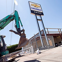 050213       Cable Hoover<br /> <br /> Construction equipment and temporary fencing surround the showroom at Amigo Chevrolet in Gallup Thursday.