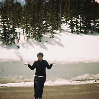 1. When was this photo taken?<br /> <br /> 2008<br /> <br /> 2. Where was this photo taken?<br /> <br /> Rocky Mountain National Park<br /> <br /> 3. Who took this photo? <br /> <br /> Me<br /> <br /> 4. What are we looking at here?<br /> <br /> My best friend about to throw a snowball on an 80 degree day<br /> <br /> 5. How does this old photo make you feel? <br /> <br /> somewhat<br /> <br /> 6. Is this what you expected to see? <br /> <br /> I wasn't sure, I knew photos of our trip to Rocky Mountain Ntln. Park was on this roll, but couldn't remember what exactly was on it<br /> <br /> 7. Does this photo bring back any memories? <br /> <br /> Yes, wonderful memories of faking British accents while driving around a National Park!<br /> <br /> 8. How do you think others will respond to this photo?<br /> <br /> With a smile