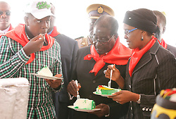 (140224) -- MARONDERA, Feb. 24 (Xinhua) -- Zimbabwe's President Robert Mugabe (C) eats a piece of cake with his wife Grace Mugabe and their son during celebrations to mark his 90th birthday  at Marondera, 75 km from Harare, Zimbabwe, February 23, 2014. Mugabe, who turned 90 on Friday, reinforcing his record as Africa's oldest president and one of the longest reigning on the continent.  (Xinhua/Stringer) (Photo by Xinhua/Sipa USA)