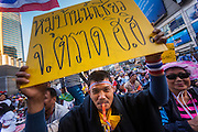"13 JANUARY 2014 - BANGKOK, THAILAND: An anti-government protestor in the Asoke intersection in Bangkok. Tens of thousands of Thai anti-government protestors took to the streets of Bangkok Monday to shut down the Thai capitol. The protest was called ""Shutdown Bangkok"" and is expected to last at least a week. The Shutdown Bangkok protest is a continuation of protests that started in early November. There have been shootings almost every night at different protests sites around Bangkok, including two Sunday night, but the protests Monday were peaceful. The malls in Bangkok stayed open Monday but many other businesses closed for the day and mass transit was swamped with both protestors and people who had to use mass transit because the roads were blocked.    PHOTO BY JACK KURTZ"