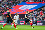 Tin Jedvaj (Croatia) with Raheem Sterling (England) in pursuit during the UEFA Nations League match between England and Croatia at Wembley Stadium, London, England on 18 November 2018.