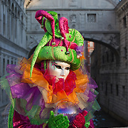 VENICE, ITALY - FEBRUARY 16:  A woman dressed with carnival costume poses for pictures on February 16, 2012 in Venice, Italy.  The annual festival, which lasts nearly three weeks, will see the streets and canals of Venice filled with people wearing highly-decorative and imaginative carnival costumes and masks. (Photo by Marco Secchi/Getty Images)