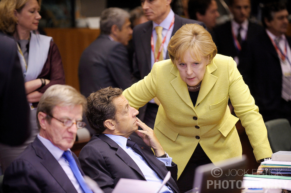 Angela Merkel, Germany's chancellor, right, speaks with Nicolas Sarkozy, France's president, during the EU Summit, in Brussels, Friday, June 19, 2009. (Photo © Jock Fistick)