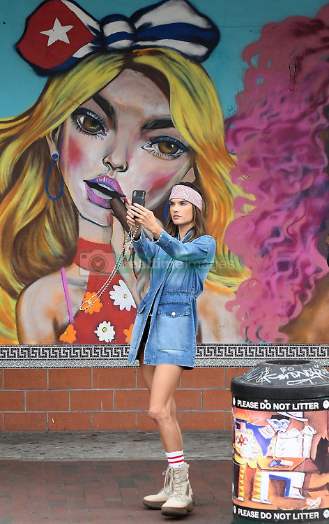Brazilian supermodel Alessandra Ambrosio shows off her legs and cleavage in a strange shorts and jean shirt outfit for Elle Italy photoshoot in Little Havana, Florida. 23 Jan 2019 Pictured: Alessandra Ambrosio. Photo credit: MEGA TheMegaAgency.com +1 888 505 6342
