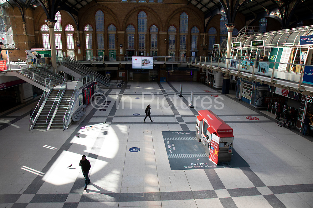 Liverpool Street railway station quiet, and almost deserted despite it being East End markets day when it is normally very busy on 22nd March 2020 in London, England, United Kingdom. Coronavirus or Covid-19 is a new respiratory illness that has not previously been seen in humans. While much or Europe has been placed into lockdown, the UK government has announced more stringent rules as part of their long term strategy, and in particular social distancing.