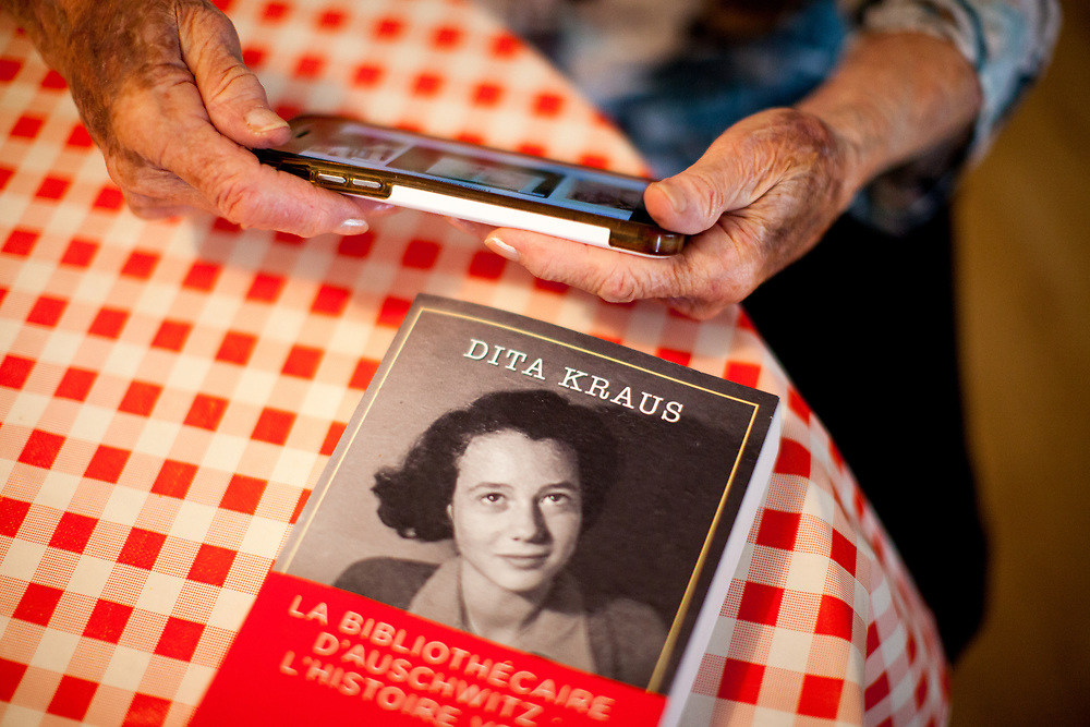 """The french edition of Dita Kraus's book in her flat in Prague Vinohrady. Born in Prague to a Jewish family in 1929, Dita Kraus has lived through the most turbulent decades of the twentieth and early twenty-first centuries. Here, Dita writes in her book """"A Delayed Life: The true story of the Librarian of Auschwitz"""" with startling clarity on the horrors and joys of a life delayed by the Holocaust. From her earliest memories and childhood friendships in Prague before the war, to the Nazi-occupation that saw her and her family sent to the Jewish ghetto at Terezín, to the unimaginable fear and bravery of her imprisonment in Auschwitz and Bergen-Belsen, and life after liberation."""