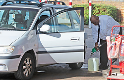 © Licensed to London News Pictures 29/09/2021.<br /> Swanley, UK, This man is also filling up a very large Jerry can. The petrol shortage continues today with motorists queuing for hours at this Co-op petrol station in Swanley, Kent. This station only had unleaded left at two pumps at 10.30am, staff said the station will be empty within two hours. Photo credit:Grant Falvey/LNP