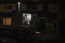 © Licensed to London News Pictures . 19/01/2017. Salford , UK . A bomb disposal team works to make safe and remove an artillery shell , discovered in the garden of a house on Clifton Drive in Salford , during work to build a garage . The house , which is occupied by a family , is evacuated and the street closed off . Photo credit: Joel Goodman/LNP