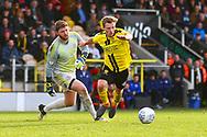 Burton Albion midfielder Jamie Allen (4) goes round Accrington Stanley goalkeeper Jonathan Maxted (1) during the EFL Sky Bet League 1 match between Burton Albion and Accrington Stanley at the Pirelli Stadium, Burton upon Trent, England on 23 March 2019.