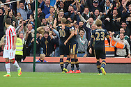 Harry Kane of Tottenham Hotspur (10) celebrates with his teammates after scoring his teams 4th goal. Premier league match, Stoke City v Tottenham Hotspur at the Bet365 Stadium in Stoke on Trent, Staffs on Saturday 10th September 2016.<br /> pic by Chris Stading, Andrew Orchard sports photography.