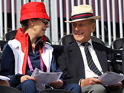 """File photo dated 29/07/12 of the Princess Royal and the Duke of Edinburgh watching the dressage stage of the eventing at Greenwich Park, London on the second day of the London 2012 Olympics. The Princess Royal has paid tribute to her father, describing him as """"my teacher, my supporter and my critic"""". Issue date: Sunday April 11, 2021. In a message posted on the Royal family's Twitter account, Anne said it was her father's example of a """"life well lived and service freely given that I most wanted to emulate"""". With the message, she posted an image of herself and the Duke of Edinburgh laughing together at a sporting event."""