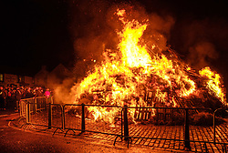 The Biggar Hogmanay bonfire lit at 9.30pm on Hogmanay by local resident Bobby Boyd MBE.<br /> <br /> This is probably the biggest new year bonfire anywhere in the UK and continues a tradition going back hundreds of years.<br /> <br /> <br /> (c) Andrew Wilson | Edinburgh Elite media