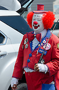 BAR HARBOR, MAINE, July 4, 2014. Jappo the Clown greets spectators at the Independence Day Parade