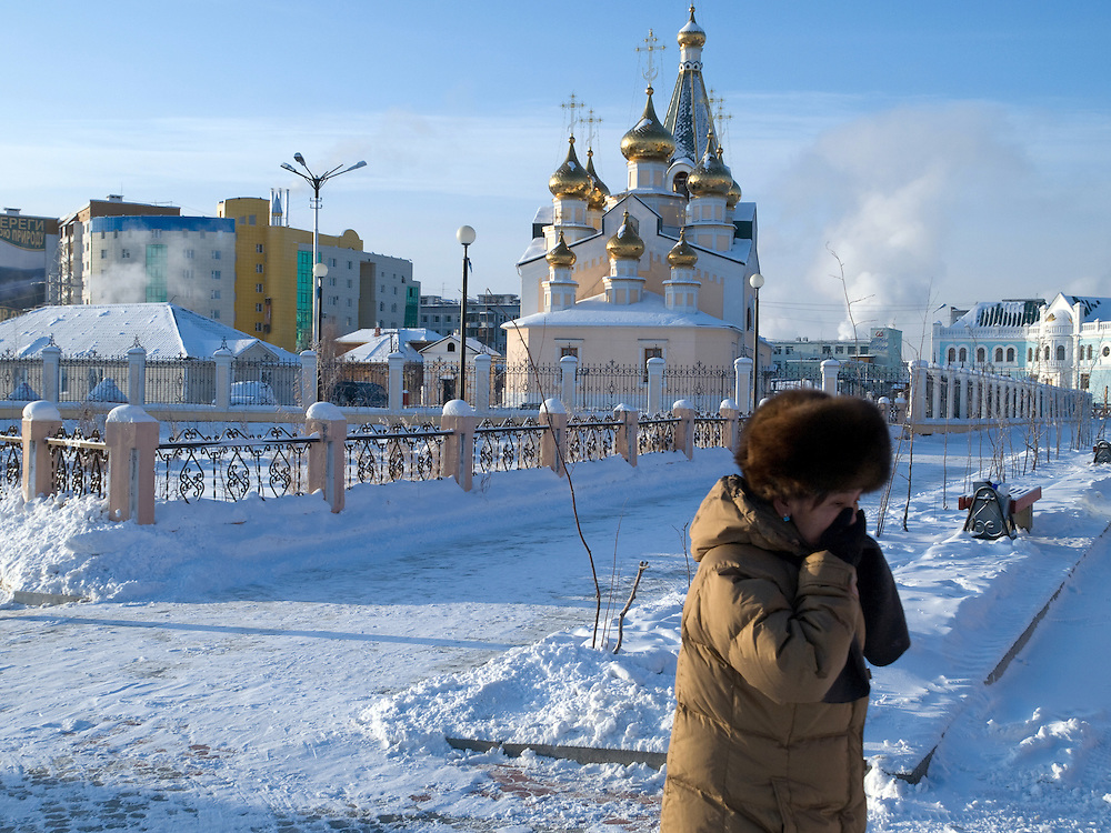 Woman is protecting her respiratory tract to breath easier on a day with -31 degrees Celsius during a walk in the city center of Yakutsk. Yakutsk is a city in the Russian Far East, located about 4 degrees (450 km) below the Arctic Circle. It is the capital of the Sakha (Jakutia) Republic (formerly the Jakut Autonomous Soviet Socialist Republic), Russia and a major port on the Lena River. Yakutsk is one of the coldest cities on earth, with winter temperatures averaging -40.9 degrees Celsius.