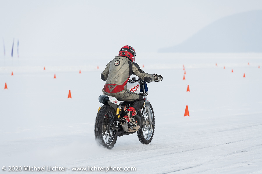 Mikhail Lyubimov racing his Harley-Davidson Sportster on which he hit 164 kmh (102 mph) on the short ice track in the Baikal Mile Ice Speed Festival. Maksimiha, Siberia, Russia. Thursday, February 27, 2020. Photography ©2020 Michael Lichter.