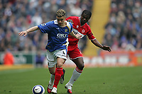 Photo: Lee Earle.<br /> Portsmouth v Middlesbrough. The Barclays Premiership. 15/04/2006.Pompey's Andres D'Allessandro (L) battles with George Boateng.