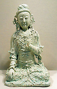 Statuette of a seated Bodhisattva. Circa late 13th-early 14th century. Yuan dynasty. Bluish glazed porcelain with relief decoration.