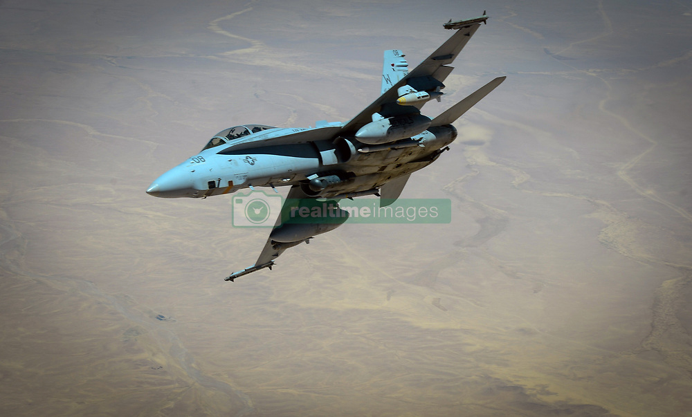 May 31, 2017 - Undisclosed, Syria - A U.S. Marine Corps F-18 Super Hornet fighter aircraft banks as it departs after receiving fuel from a 908th Expeditionary Air Refueling Squadron KC-10 Extender during a mission in support of Operation Inherent Resolve May 31, 2017 in southwest Asia. (Credit Image: © Michael Battles/Planet Pix via ZUMA Wire)
