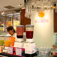 Asia, Japan, Tokyo. A fruit juice bar provides refreshment for shoppers in a Toyko Department Store.