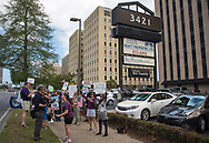Metairie Indivisible protest in front of Senator Cassidy's office in Metairie, LA.