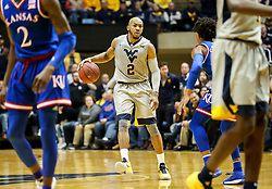 Jan 15, 2018; Morgantown, WV, USA; West Virginia Mountaineers guard Jevon Carter (2) dribbles during the second half against the Kansas Jayhawks at WVU Coliseum. Mandatory Credit: Ben Queen-USA TODAY Sports