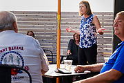 16 JULY 2021 - ALTOONA, IOWA: Congressperson CINDY AXNE (D - IA 3rd District) talks to constituents during a town hall meeting at the Brick and Ivy Rooftop in Altoona. About 25 people attended the meeting. Axne is the only Democratic Congressperson from Iowa. Axne has not decided yet if she is going to run for reelection in 2022, but three Republicans have already declared their intention to run for the seat. Her set will probably be the most contested congressional seat in Iowa.         PHOTO BY JACK KURTZ