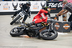 Hooligan Buddy Suttle crashing through turn one at the Flat Out Friday flat track racing on the Dr. Pepper-covered track in the UW-Milwaukee Panther Arena during the Harley-Davidson 115th Anniversary Celebration event. Milwaukee, WI. USA. Friday August 31, 2018. Photography ©2018 Michael Lichter.