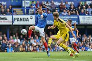Portsmouth Midfielder, Tom Naylor (7) with a shot at goal during the EFL Sky Bet League 1 match between Portsmouth and Oxford United at Fratton Park, Portsmouth, England on 18 August 2018.