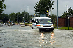 A Police van drives through the flooding on The Common Ecclesfield Sheffield South Yorkshire<br /> 25 June 2007<br /> Image COPYRIGHT Paul David Drabble