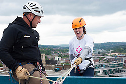 Laurie Crabtree takes her turn at the Plusnet and Hill Dickinson Charity Abseil 111 feet down the Balance building in Sheffield to raise money for Roundabout and Saint Lukes Hospice on Wednesday <br /> <br /> 11 June 2013<br /> Image © Paul David Drabble<br /> www.pauldaviddrabble.co.uk