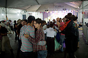 People dancing indoors at a Gaucho cowboy Rodeo, Flores de Cunha, Rio Grande do Sul.
