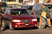 A passer by stops to view the scene moments after armed gunman shot dead a former police officer during morning rush hour along a main road in Juarez, Mexico January 16, 2009  The shooting, believed linked to the ongoing drug war which has already claimed more than 40 people since the start of the year. More than 1600 people were killed in Juarez in 2008, making Juarez the most violent city in Mexico.    (Photo by Richard Ellis)