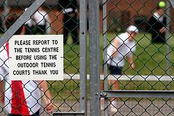 Schoolchildren playing tennis; Weybridge Surrey UK