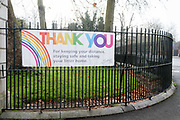 A National Health Service NHS banner thanks the public for keeping their distance in local areas during the Coronavirus pandemic, at the entrance to Dulwich Park in south London, on 8th December 2020, in London, England.