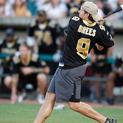 Apr 28, 2010; Metairie, LA, USA; Drew Brees (9) connects for a homerun during the Heath Evans Foundation charity softball featuring teammates of the Super Bowl XLIV Champion New Orleans Saints at Zephyrs Field.  Mandatory Credit: Derick E. Hingle-US-PRESSWIRE.