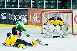 Ken Ograjensek of HK Olimpija vs goalie Ziga Antonic of HK Slavija during of ice-hockey match between HK Olimpija and HK Slavija in  SLOHOKEJ league, on September 21, 2011 at Hala Tivoli, Ljubljana, Slovenia. (Photo By Matic Klansek Velej / Sportida)
