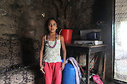 Daniela, aged 8, makes herself. Child of Adriaua, godmother to Catalina, In their home in Alexandria..Roma Gypsies left India 1000 years ago. Often nomadic. A collection of tribes with their own languages and culture, pushed by the Ottoman empire towards Europe, used and sold as mercenaries, slaves, prostitutes. They endured 500 years of slavery until mid 19th century. A million were killed in the holocaust. Hundreds of thousands exiled and refugees from kosovo. Many Eastern Europe Roma come to the west seeking a better life. They are shunned, marginalized, excluded. Both indigenous and foriegn Roma, whether European citizens or not, lack the opportunities of others, living on the periphery, in the brunt of racism, often deported back to their countries of origin.
