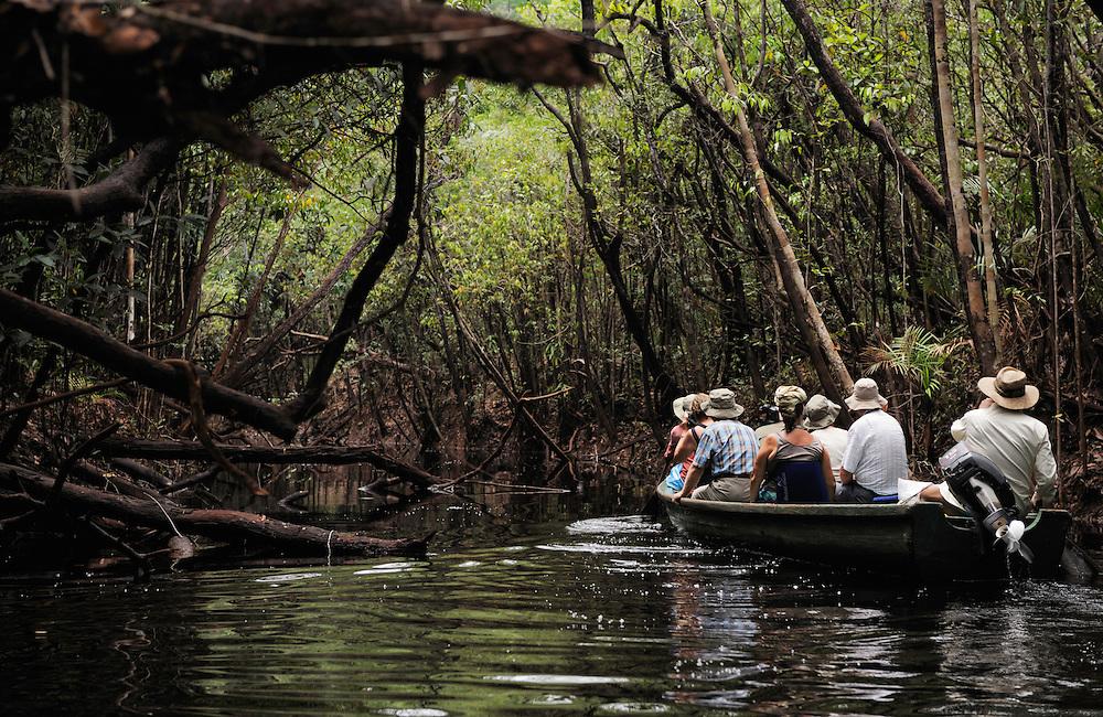 Tourists on a boat, Rio Negro, Amazonas, Brazil.