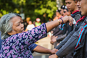 """01 FEBRUARY 2014 - BANGKOK, THAILAND: A Thai woman tries to get past police lines to go to her polling place in the Din Daeng area of Bangkok. Thais went to the polls in a """"snap election"""" Sunday called in December after Prime Minister Yingluck Shinawatra dissolved the parliament in the face of large anti-government protests in Bangkok. The anti-government opposition, led by the People's Democratic Reform Committee (PDRC), called for a boycott of the election and threatened to disrupt voting. Many polling places in Bangkok were closed by protestors who blocked access to the polls or distribution of ballots. The result of the election are likely to be contested in the Thai Constitutional Court and may be invalidated because there won't be quorum in the Thai parliament.    PHOTO BY JACK KURTZ"""