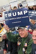 Supporters of Republican presidential candidate billionaire Donald Trump gather before the start of a campaign rally at the Myrtle Beach Convention Center November 24, 2015 in Myrtle Beach, South Carolina.