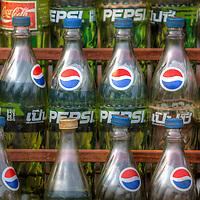 Used soda pop bottles are recycled as gasoline containers Snuol, Cambodia