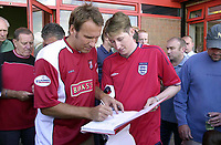 MERSON....PIC TIM EASTHOPE..15..... Pictured is soccer star Paul Merson signing for Walsall from Portsmouth, pictured with Nick Price Walsall fan