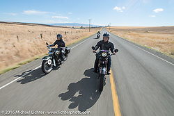 Licenced Harley-Davidson artist Scott Jacobs riding his 1926 Harley-Davidson JD rides alongside his wife Sharon Jacobs on her 1936 Harley-Davidson VLH during Stage 14 - (284 miles) of the Motorcycle Cannonball Cross-Country Endurance Run, which on this day ran from Meridian to Lewiston, Idaho, USA. Friday, September 19, 2014.  Photography ©2014 Michael Lichter.