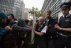 © licensed to London News Pictures. London, UK 19/10/2012. Protester and police clashing outside Department for Communities and Local Governments in London during a protest to mark the first anniversary of the Dale Farm eviction. Photo credit: Tolga Akmen/LNP
