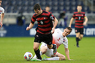 13 December 2015: Stanford's Foster Langsdorf (2) is fouled by Clemson's Patrick Bunk-Andersen (DEN) (3). The Clemson University Tigers played the Stanford University Cardinal at Sporting Park in Kansas City, Kansas in the 2015 NCAA Division I Men's College Cup championship match. Stanford won the game 4-0.