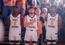 Dec 22, 2018; Morgantown, WV, USA; West Virginia Mountaineers guard Brandon Knapper (2) and West Virginia Mountaineers guard Jordan McCabe (5) and West Virginia Mountaineers guard Trey Doomes (0) pause for the national anthem before their game against the Jacksonville State Gamecocks at WVU Coliseum. Mandatory Credit: Ben Queen-USA TODAY Sports