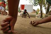 Children play marbles in Alemanha, Honduras.  Honduras is considered the third poorest country in the Western Hemisphere (Haiti, Nicaragua). With over 50% of the population living below the poverty line and 28% unemployed, Hondurans frequently turn to illegal immigration as a solution to their desperate situation. The Department of Homeland Security has noted an 95% increase in illegal immigrants coming from Honduras between 2000 and 2009, the largest increase of any country.